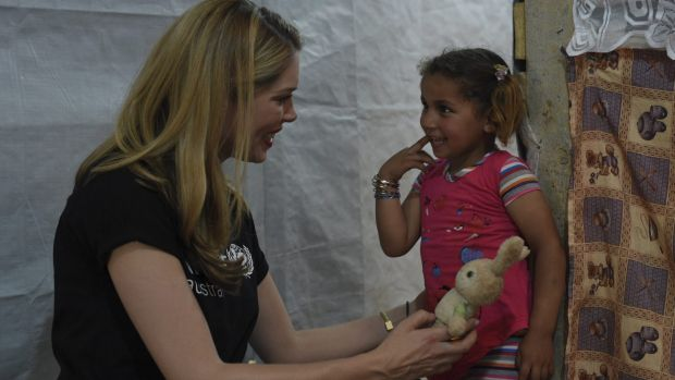 Tara Moss meets Reem, 4, for the first time in a UNICEF-supported early education program run for the children of seven ...