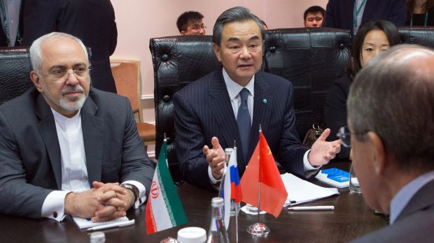 Iranian Foreign Minister Mohammad Javad Zarif (left) and Chinese Foreign Minister Wang Yi (centre) meeting with their ...