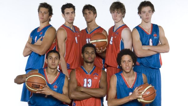 Part of a former AIS basketball squad, including Patty Mills, front centre, and Matthew Dellavedova, back right.