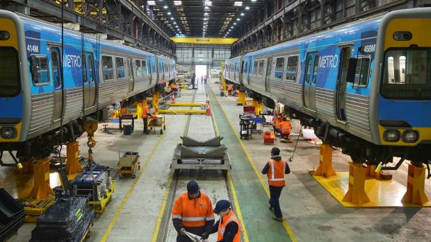 Downer EDI workers work on building new rail carriages.