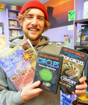 Tenzin Butt with some of the crop circle merchandise available in Central Tilba's Gulaga Gallery and Bookshop.