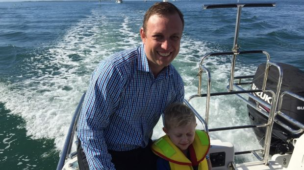 Environment Minister Dr Steven Miles with his son Aidan on Moreton Bay.