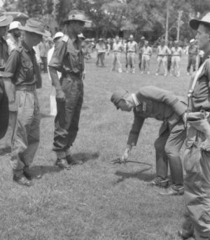 Major General Uno surrenders to Lieutenant Colonel Ewan Murray Robson, during the Japanese surrender ceremony.
