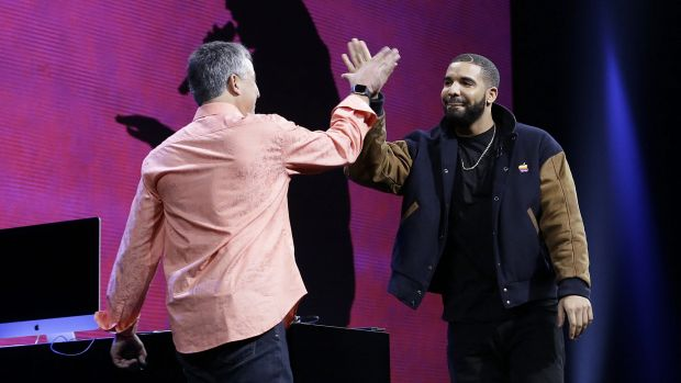 Canadian rapper Drake high-fives Eddy Cue, Apple senior vice-president of Internet Software and Services, at the Apple ...