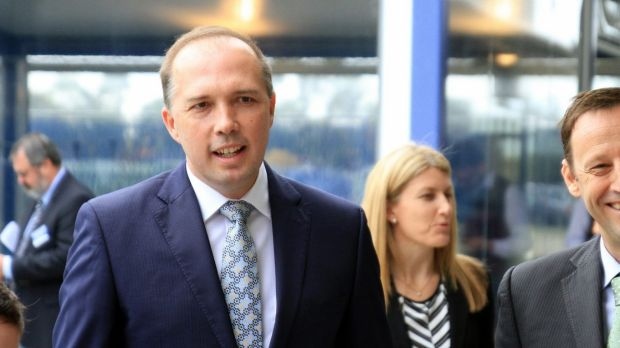 Immigration Minister Peter Dutton ducked one shoe thrown at him and caught another on Sunday morning.