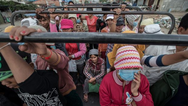 Around 700,000 Cambodians, mostly women, work in  garment factories. Thousands of the workers cram together on trucks ...