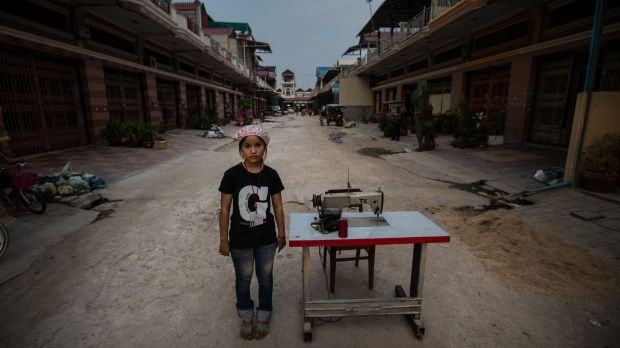 Clothing worker Vien Dyna, 16, says supervisors in a stifling hot Cambodian factory scream abuse at her as she struggles ...