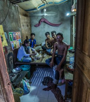 A family of five live in this tiny room made of scrap timber and cardboard  near a Phnom Penh garment factory.