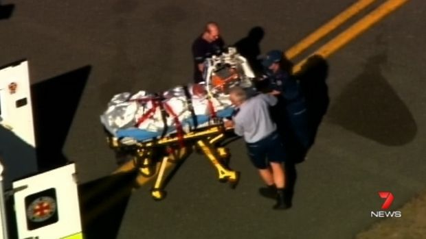 A Ravenshoe burns victim arrives in Brisbane for treatment on Wednesday.