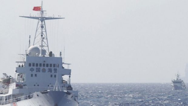 Chinese Coast Guard ships in disputed waters in the South China Sea last year.