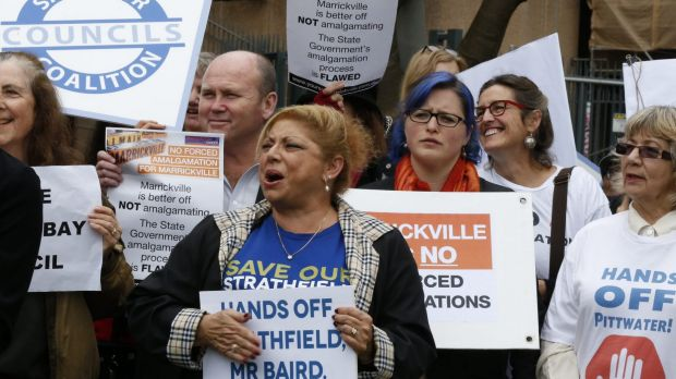 Protesters rally against forced amalgamations.