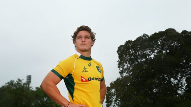 SYDNEY, AUSTRALIA - JUNE 11:  Michael Hooper poses for a picture with a Wallabies jersey after signing a new contract ...