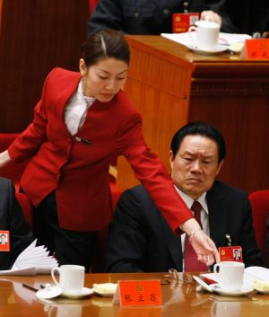 Then China's Public Security Minister Zhou Yongkang attends the opening ceremony of the 17th Party Congress at the Great ...