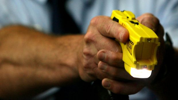 Senior Constable Peter Clark has denied Robert Cunningham and Catherine Atoms were handcuffed when they were tasered.