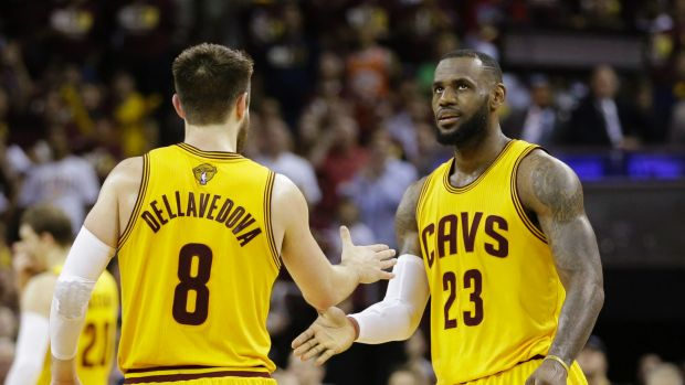 Cleveland Cavaliers forward LeBron James (23) celebrates with teammate Matthew Dellavedova during the second half of ...