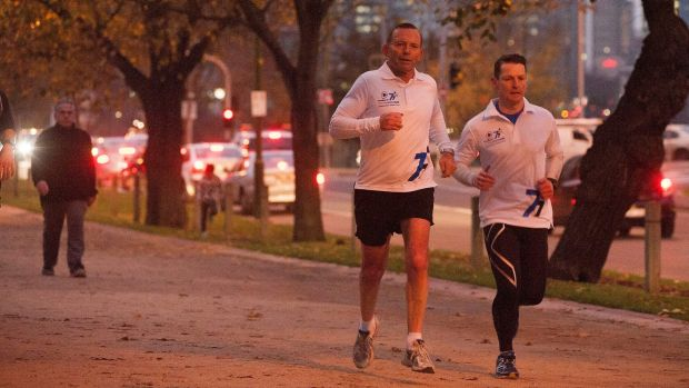 Prime Minister Tony Abbott, seen out jogging in Melbourne on Friday, said the government stopped people-smuggler boats ...