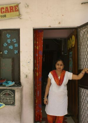 Rekha Saraswat runs a child care centre two doors from the adoption racket's office.