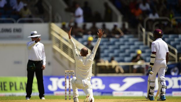 Lyon rampant: Australia's Nathan Lyon successfully appeals for leg-before against West Indies' Darren Bravo on day two ...