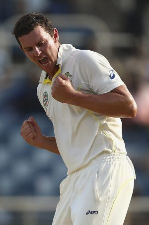 Australia's Josh Hazlewood celebrates his removal of West Indies captain Denesh Ramdin late on day two of the second ...