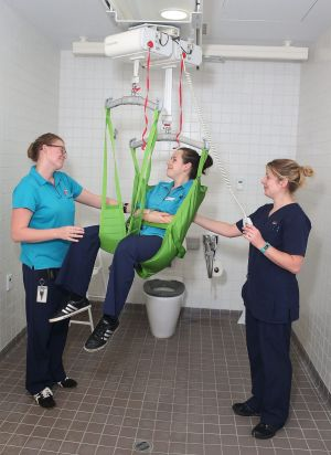 Erin Wagner, Rebecca Donnelly and Louise Bourrigan demonstrate the patient transfer hoist at Campbelltown Hospital.