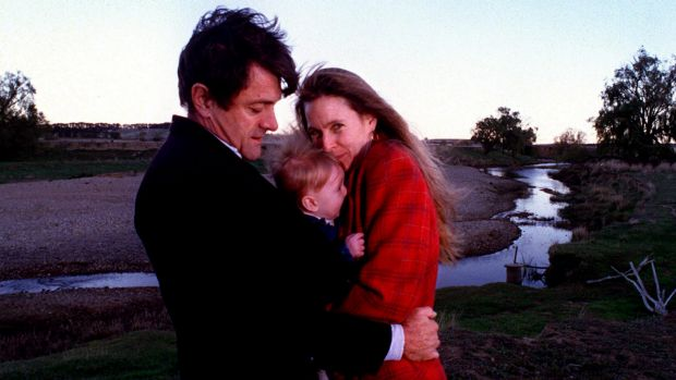 Philip Toyne and his wife Molly hug their son Atticus in 1999.