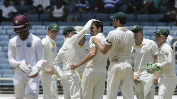 Australia's Mitch Johnson (fourth from right) is congratulated by teammates after bowling West Indies' batsman Shai Hope ...