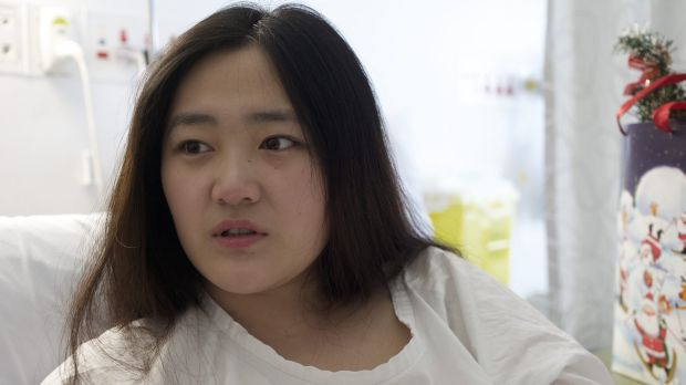 """Bankstown fire survivor Yinuo """"Ginger"""" Jiang in hospital at Liverpool in 2012."""