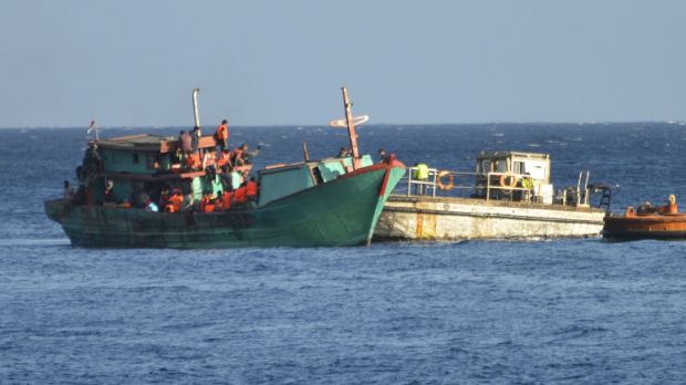 Two charged over Chinese boat arrivals