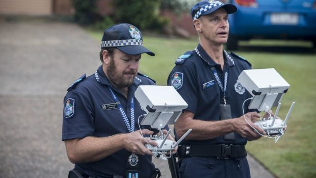 Police monitor aerial images captured by a drone in Queensland.