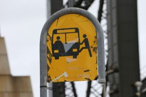 An old-style bus stop with a pictogram.