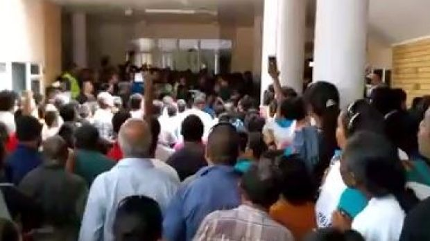 People protest against corruption in Nauru's parliament on Tuesday.