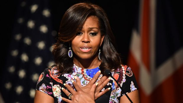 Michelle Obama told the summit attitudes must change to ensure all girls get an education.
