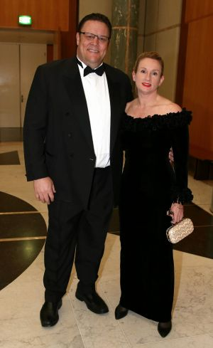 Arriving with wife Tess for the Midwinter Ball at Parliament House in June.