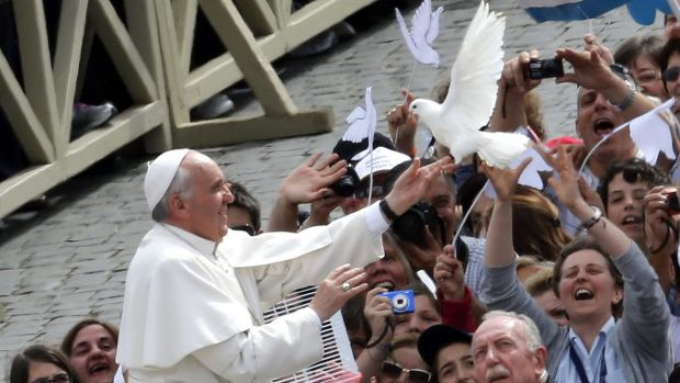 Taking a stand on the environment ... Pope Francis holds a dove before his general audience at San Peter's Square at the ...