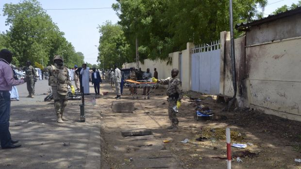 Security officers stand at the site of a suicide bombing in Ndjamena, Chad, on Monday.