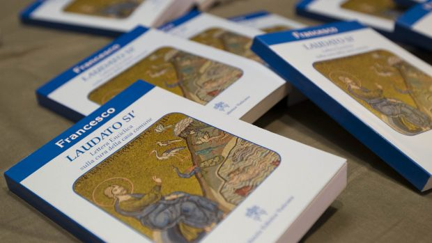 Copies of Pope Francis' encyclical  'Laudato Si  (Praise Be)' are displayed prior to the start of a press conference, at ...