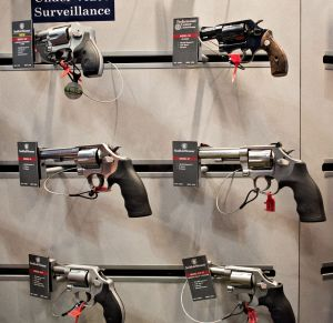 Revolvers sit on display in the Smith & Wesson booth on the exhibition floor of the NRA convention.