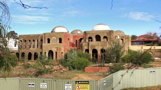 """In late October the Oswals agreed to demolish their sprawling riverside pile in Perth dubbed """"Taj-on-Swan""""."""