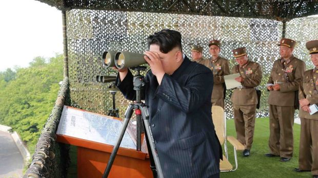 North Korean leader Kim Jong-Un inspecting a firing contest of artillery personnel in an undated picture released from ...