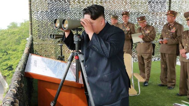 North Korean leader Kim Jong-Un inspecting a firing contest.