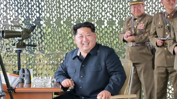 North Korean leader Kim Jong Un smiles as he watches a firing contest of anti-aircraft artillery personnel in this photo ...