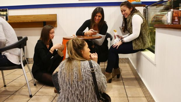 Women enjoy a meal in the floor of a pie restaurant in Newtown.