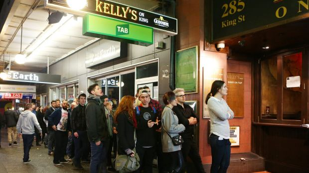 People line up to get into a pub in Newtown on June 13.