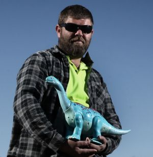Charges dropped: Rickey Caton was arrested after he pointed a toy dinosaur at police.
