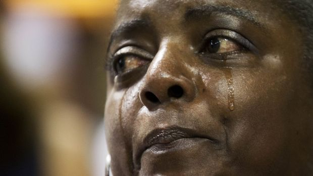 Barbara Lloyd of Charleston cries during the singing of 'We Shall Overcome' at a memorial service for the victims.