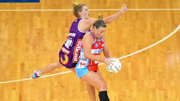 BRISBANE, AUSTRALIA - JUNE 21: Kim Green of the Swifts and Gabi Simpson of the Firebirds compete for the ball during the ...