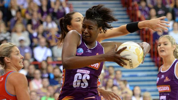 BRISBANE, AUSTRALIA - JUNE 21: Romelda Aiken of the Firebirds competes for the ball during the 2015 ANZ Championship ...