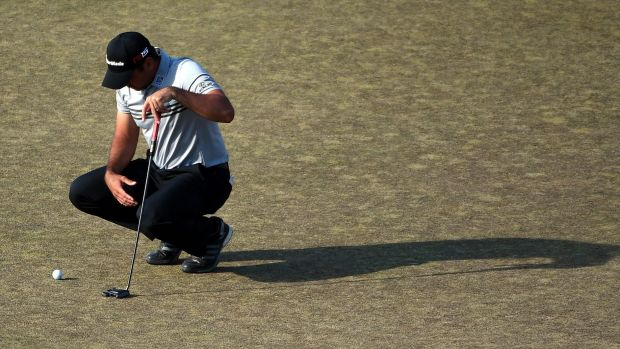 Jason Day of Australia waits on the 18th green during the third round of the US Open.