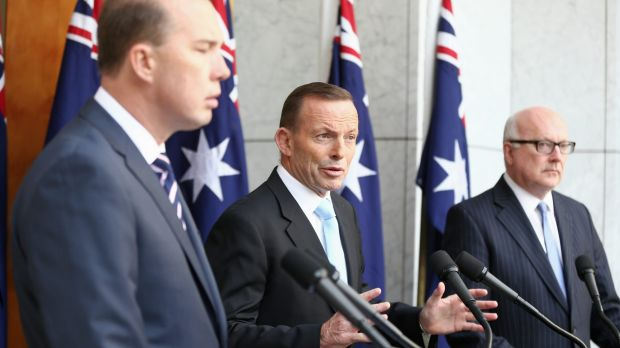 Prime Minister Tony Abbott, pictured with Peter Dutton and George Brandis, stepped up his attack on the ABC on Thursday.