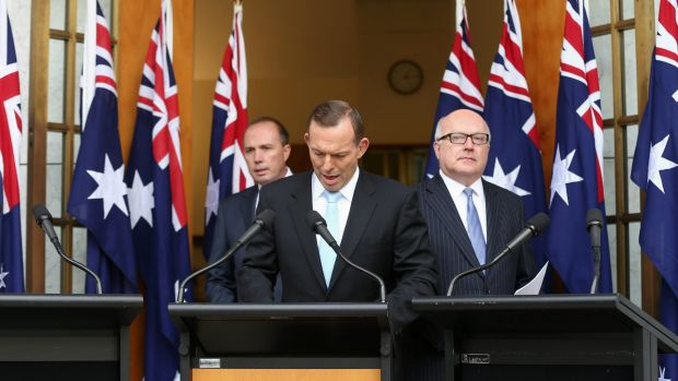 Prime Minister Tony Abbott with Immigration Minister Peter Dutton and Attorney-General George Brandis during a joint ...